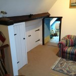 Loft games room with low access to childs bedroom