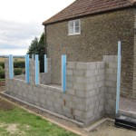 Blockwork going up with insulated cavity closers in place
