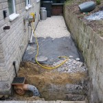 The rear storm water drain being fitted