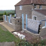 With the blockwork complete, work began on the natural stone. The cavity was filled with high performance insulation