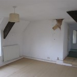 Another view of the supposedly solid main bedroom floor with the carpets lifted