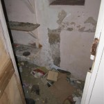 This was the rodent infested cupboard under the stairs. The pile of rubble on the floor is the spoil of their 'mining' through the walls and under the road outside!