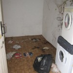 The annexed utility room after being emptied of years of rubbish