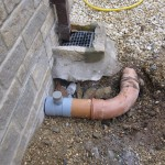 The storm water drain at the back of the extension was connected to a new soakaway, and the shower drain connected to the existing foul water system