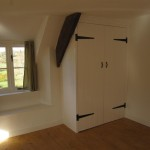 A built in traditional wardrobe gives great storage without intruding into the bedroom