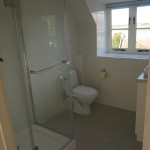 The fully tiled bathroom after work was completed