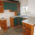 The original kitchen was re-used and a family sized wall mounted oil boiler installed for the heating