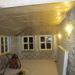 With the building in the dry and the floor laid, we fitted the insulation in the roof