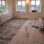 The concrete floor was first battened and acoustic insulation (this is going to be a music room) laid before the solid oak flooring was fitted