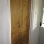 A reclaimed pine door was sourced to fit to the shower room