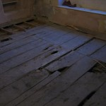 The original elm floor hidden under a newer pine floor