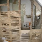 An original wattle and daub wall between a bedroom and the bathroom