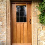 Period oak door with genuine leadlight