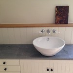 Small bespoke vanity unit with local natural stone worktop