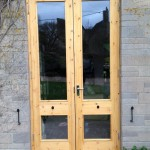 Pair of primed softwood French doors